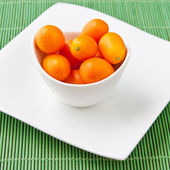 Fresh ripe Kumquats in a bowl — Stock Photo