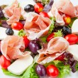 Fresh spring mix salad italian style with prosciutto and mozzare — Stock Photo