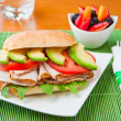 Sandwich with turkey, tomato, avocado and arugula. — Stock Photo