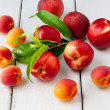Colorful summer fruits - apricots, nectarines and peaches on woo — Stockfoto