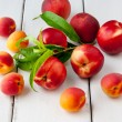 Colorful summer fruits - apricots, nectarines and peaches on woo — Stok fotoğraf