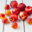 Colorful summer fruits - apricots, nectarines and peaches on woo — Stock Photo