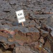 The Road Closed sign on the road buried in lava from the erupti — Stock Photo #30009409