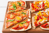 Backed flatbread with variety of toppings. — Stock Photo