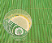 Glass of water with lemon — Stock Photo