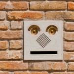 A modern intercom doorbell panel on old brick wall. — Stock Photo