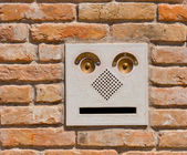 A modern intercom doorbell panel on old brick wall. — Stock Photo