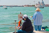 Two female artists painting in Venice. — Stock Photo