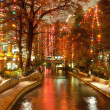 Постер, плакат: River walk in San Antonio city at night at holiday season