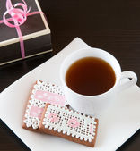 Homemade gingerbread cookies and cup of tea. — Stock Photo