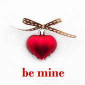Be mine greeting card with red heart on the snow — Stock Photo