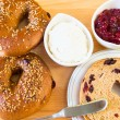 Homemade whole grain bagels with sesame seeds and cranberries. — Stock Photo #40302973