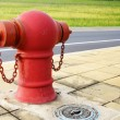 Pipe fittings in red street — Stock Photo