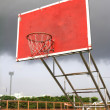 Old outdoor basketball hoop agains — Stock Photo #18537953