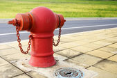 Pipe fittings in red street — Stockfoto