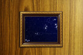 A photo of a wooden picture frame with the night sky setting ins — Stock Photo