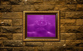 A photo of a wood frame on brick wall with the water drop setting inside — Stock fotografie