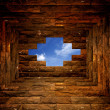 Blue sky with sunlight through the hole in the brick wall — Stock Photo #19101075