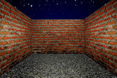 Room with a brick wall, the Night sky background — Stock Photo