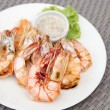 Grilled shrimps with seafood sauce on white plate — Stock Photo