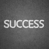Success text written on blackboard for background — 图库照片