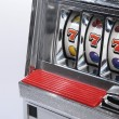 Slot machine and jackpot three seven — Stock Photo #14001122