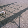 Rowing boat paddles and shadows on ground — Stockfoto #15283791
