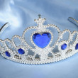 False tiara with diamonds and blue gem - Stock Photo