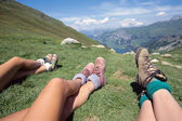 Hikers and mountains landscape on a sunny day in Savoy, France — Stock Photo