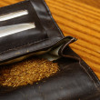 Rolling tobacco pouch — Stock Photo