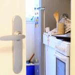 Mess in domestic kitchen through door — Foto de Stock