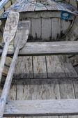 Wooden small boat and paddles — Stock Photo