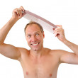 Smiling man hand holding comb on the head — Stock Photo