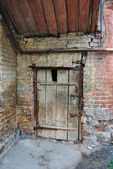 Old closed door in old abandoned house — Stock Photo