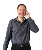 Smiling man with mobile phone isolated on the white background — Stock Photo
