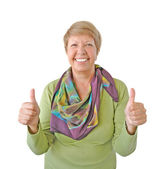 Smiling woman in green showing thumb up isolated on white backgr — Stock Photo