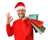 Smiling christmas man wearing a santa hat isolated on the white — Stock Photo