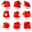 Stock Photo: Set of red SantClaus hats isolated on white background