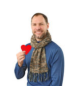 Smiling man holding a red heart on his hand isolated on a white — Stock Photo