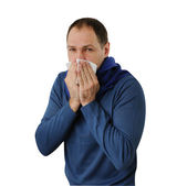 Man blowing his nose isolated on white background — Stock Photo