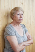 Sad elderly woman thinks — Stock Photo
