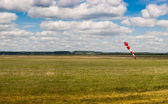 Aerodrome with a weather vane. Blue sky with white clouds — Стоковое фото
