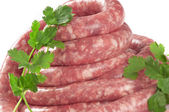 A natural raw sausage on white — Stock Photo