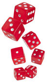 Red shiny dices on white background — Stock Photo