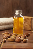 Seeds of argan with light and soap — Stock Photo
