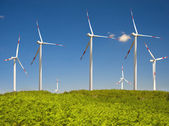 Modern white wind turbine with blue sky — Stock Photo