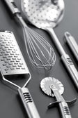 Steinless kitchen stuff on gray background — Stock Photo