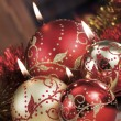 Christmas baubles on background of defocused  lights — Stock Photo