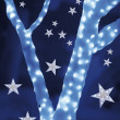 Stars on background of defocused blue lights and tree — ストック写真
