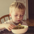 Boy Eating his breakfast Early in the Morning — Stock Photo